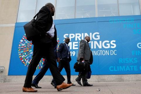 Delegates walk outside the International Monetary Fund headquarters building ahead of the IMF/World Bank spring meetings in Washington, U.S., April 8, 2019. REUTERS/Yuri Gripas - RC17038BDDE0
