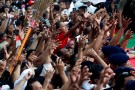 Supporters reach for a t-shirt at a carnival during a campaign rally of the Indonesia's president and presidential candidate for the next election Joko Widodo and his running mate for the upcoming election Ma'ruf Amin in Tangerang, Banten province, Indonesia, April 7, 2019. REUTERS/Willy Kurniawan - RC1C252882E0