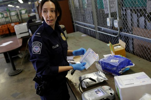 DATE IMPORTED: July 11, 2018 U.S. Customs and Border Protection officer Ella Olejnik looks at the paperwork on a package before inspecting the substance inside at the International Mail Facility at O'Hare International Airport in Chicago, Illinois, U.S. November 29, 2017. Picture taken November 29, 2017. REUTERS/Joshua Lott