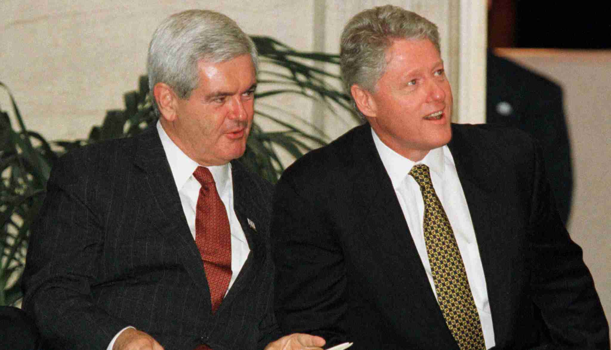 U.S. House of Representatives Speaker Newt Gingrich (L) and President Bill Clinton sit during ceremonies at the U.S. Capitol [honouring South African President Nelson Mandela] September 23. Gingrich said earlier that it was too early to talk of compromise with the White House and that the impeachment investigation of Clinton should continue. - PBEAHUMGBCS