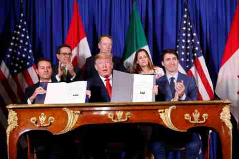 U.S. President Donald Trump, Canada's Prime Minister Justin Trudeau and Mexico's President Enrique Pena Nieto attend the USMCA signing ceremony before the G20 leaders summit in Buenos Aires, Argentina November 30, 2018. REUTERS/Kevin Lamarque - RC156BBD3810
