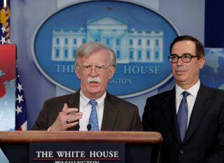 White House National Security Adviser John Bolton and Treasury Secretary Steven Mnuchin.