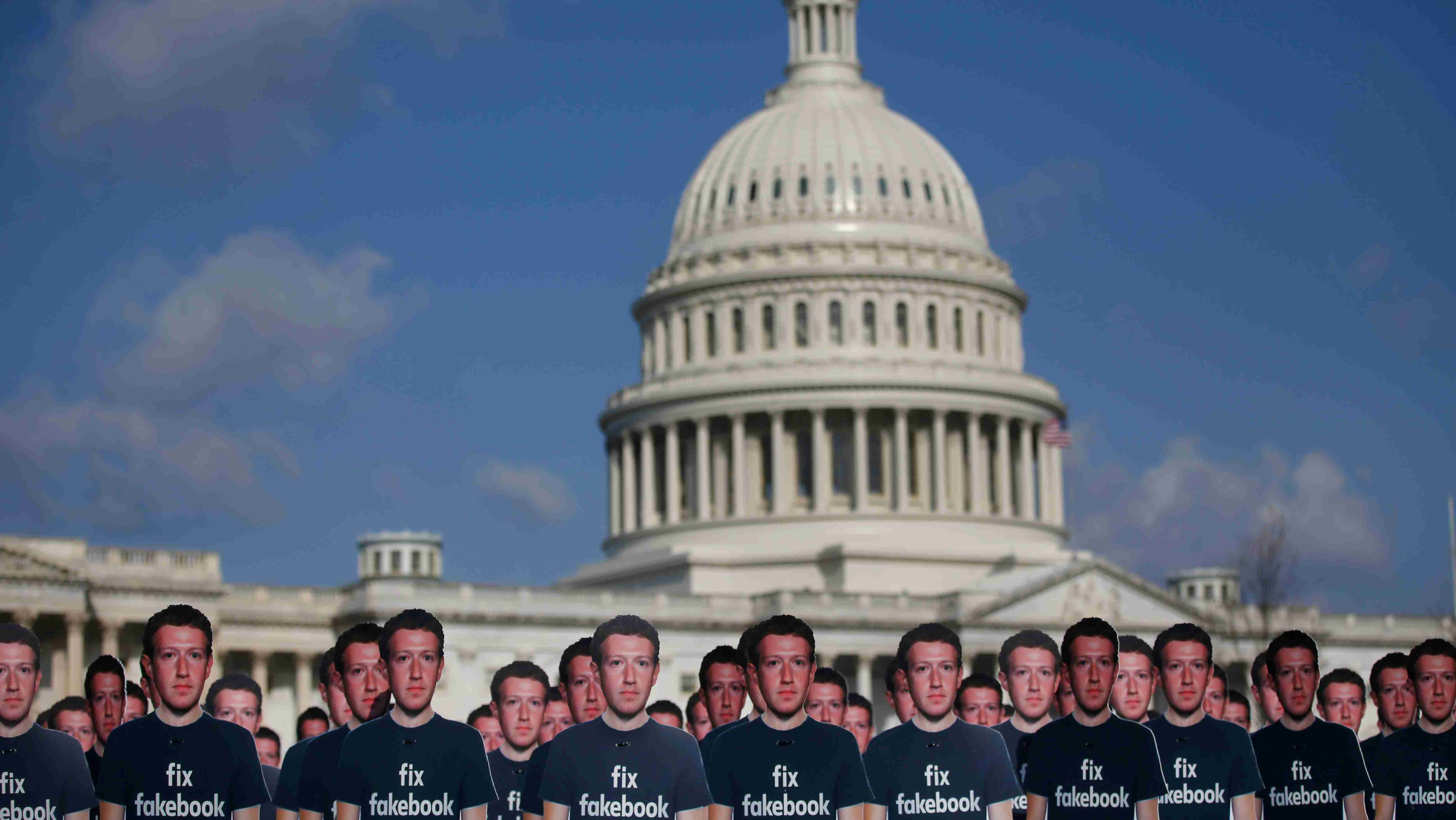 Dozens of cardboard cut-outs of Facebook CEO Mark Zuckerberg sit outside of the U.S. Capitol Building as part of an Avaaz.org protest in Washington, U.S., April 10, 2018. REUTERS/Leah Millis - RC1CA8A95B60