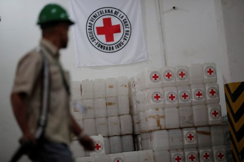 The logo of the International Federation of Red Cross is seen on boxes at the warehouse of Venezuelan Red Cross, where international humanitarian aid for Venezuela is being stored, in Caracas, Venezuela, April 22, 2019. REUTERS/Ueslei Marcelino - RC12F43CB840