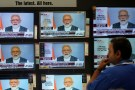 A man watches Prime Minister Narendra Modi addressing to the nation, on TV screens inside a showroom in Mumbai, India, March 27, 2019. REUTERS/Francis Mascarenhas - RC1B207CBD20