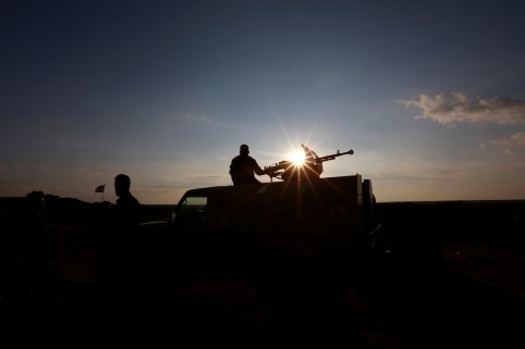A Popular Mobilisation Forces (PMF) fighter rides in a military vehicle at the Iraqi-Syrian border near al-Qaim, Iraq, November 26, 2018. Picture taken November 26, 2018. REUTERS/Alaa al-Marjani - RC13847779F0