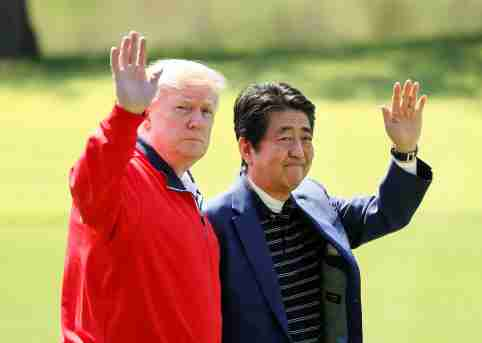 U.S. President Donald Trump and Japanese Prime Minister Shinzo Abe wave on the way to the course to play golf at Mobara Country Club in Mobara, Chiba Prefecture, east of Tokyo, Japan May 26, 2019. Kimimasa Mayama/Pool via Reuters - RC15048539F0