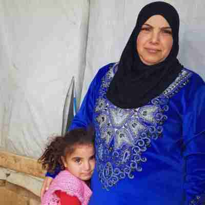 Mirna in a refugee camp with her mom