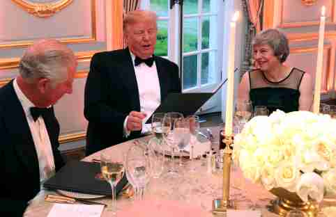 U.S. President Donald Trump, British Prime Minister Theresa May and Britain's Charles, Prince of Wales speak at a dinner at Winfield House, during Trump's state visit in London, Britain June 4, 2019. Chris Jackson/Pool via REUTERS - RC1FE84AE4E0