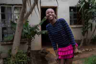 "Khanyo Mchunu, 13, posing for a photograph in front of her house in Embo, South Africa, November 30, 2016. REUTERS/Rogan Ward SEARCH ""CHRISTMAS WISHES"" FOR THIS STORY. SEARCH ""WIDER IMAGE"" FOR ALL STORIES. - RC13B192B6E0"