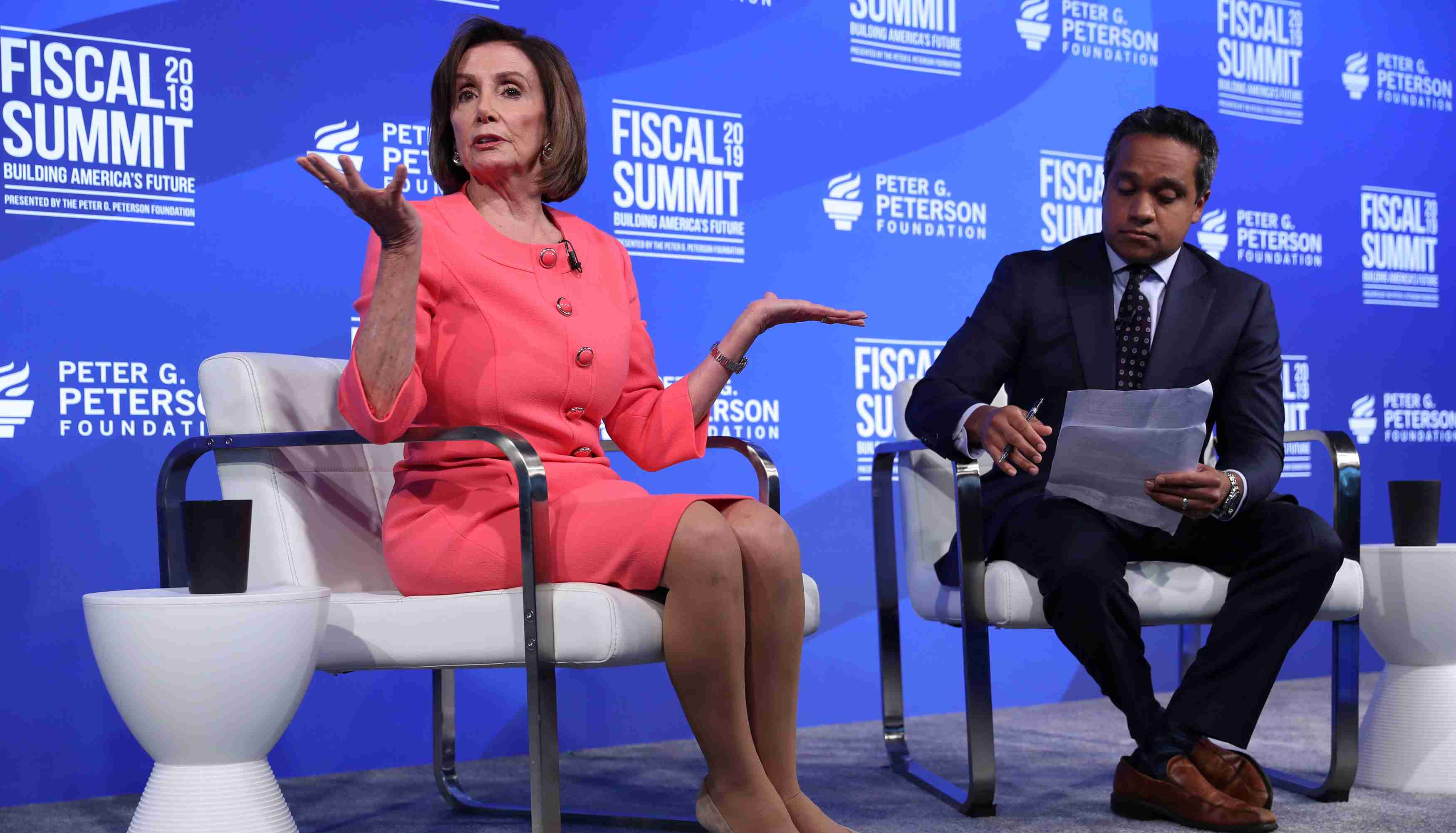 U.S. House Speaker Nancy Pelosi (D-CA) sits for an onstage interview about the U.S. budget with CNN reporter Manu Raju at the Peterson Foundation's annual Fiscal Summit in Washington, U.S. June 11, 2019.  REUTERS/Jonathan Ernst - RC19F3443080