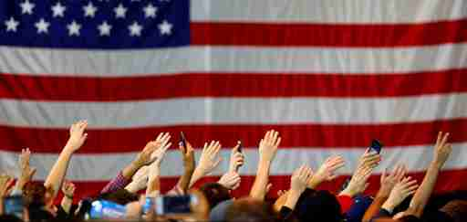 Supporters wave their hands in unison as they gather at a rally for U.S. Democratic presidential candidate Bernie Sanders in Anaheim, California, U.S., May 24, 2016. REUTERS/Mike Blake  - D1AETFXPDRAB