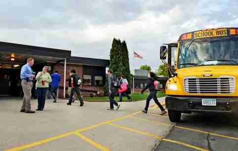 """Students arrive for class at Mahnomen Elementary School in Mahnomen, Minnesota September 26, 2013. The U.S. government may have headed off some of the most dire predictions about the """"sequester,"""" but over seven months, the across-the-board spending cut has thrown sand into the gears of the economic recovery. Mahnomen school district, which serves the White Earth Indian reservation in Minnesota, lost three percent of its funding due to the sequester. The district didn't replace a teacher who retired and has scaled back on homework tutoring and an alternative-school program for teenage mothers. Another year of cuts could force the school to lay off teachers and scale back bus service, superintendent Jeff Bisek says.  Picture taken September 26, 2013. To match Insight USA-BUDGET/SEQUESTER    REUTERS/Dan Koeck   (UNITED STATES - Tags: EDUCATION POLITICS BUSINESS) - GM1E99S159R01"""