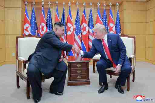 U.S. President Donald Trump and North Korean leader Kim Jong Un shake hands during a meeting at the demilitarized zone (DMZ) separating the two Koreas, in Panmunjom, South Korea, June 30, 2019. KCNA via REUTERS    ATTENTION EDITORS - THIS IMAGE WAS PROVIDED BY A THIRD PARTY. REUTERS IS UNABLE TO INDEPENDENTLY VERIFY THIS IMAGE. NO THIRD PARTY SALES. SOUTH KOREA OUT. NO COMMERCIAL OR EDITORIAL SALES IN SOUTH KOREA. - RC1484CCD790