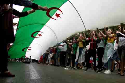 Demonstrators hold a national flag during a protest demanding the removal of the ruling elite in Algiers, Algeria July 12, 2019. REUTERS/Ramzi Boudina - RC123B9B63D0
