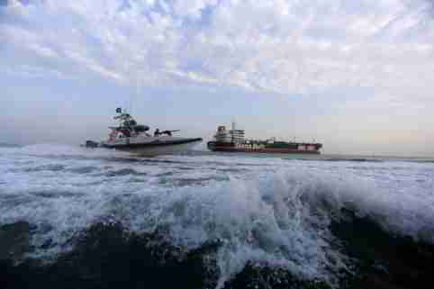 A boat of the Iranian Revolutionary Guard sails close to Stena Impero, a British-flagged vessel owned by Stena Bulk, near Bandar Abbas port, Iran July 21, 2019. Picture taken July 21, 2019. Fars News Agency/ WANA Handout via REUTERS ATTENTION EDITORS - THIS IMAGE WAS PROVIDED BY A THIRD PARTY. - RC1D73A09A90
