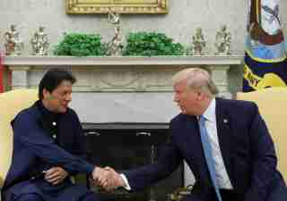 U.S. President Donald Trump greets Pakistan's Prime Minister Imran Khan in the Oval Office at the White House in Washington, U.S., July 22, 2019. REUTERS/Jonathan Ernst - RC1BBD405CD0