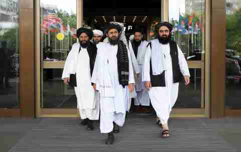 Members of a Taliban delegation, led by chief negotiator Mullah Abdul Ghani Baradar (C, front), leave after peace talks with Afghan senior politicians in Moscow, Russia May 30, 2019. REUTERS/Evgenia Novozhenina - RC1C12362C10