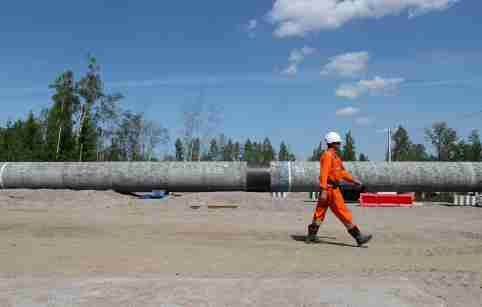 A worker walks near a pipe at the construction site of the Nord Stream 2 gas pipeline, near the town of Kingisepp, Leningrad region, Russia June 5, 2019. REUTERS/Anton Vaganov - RC1AFBC68700