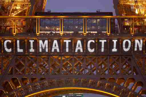 """The slogan """"Climate action"""" is projected on the Eiffel Tower as part of the World Climate Change Conference 2015 (COP21) in Paris, France, December 11, 2015.   REUTERS/Charles Platiau - LR1EBCB1BKV2N"""