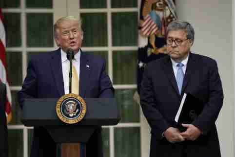 U.S. President Donald Trump stands with Attorney General Bill Barr as he announces his administration's effort to gain citizenship data during the 2020 census at an event in the Rose Garden of the White House in Washington, U.S., July 11, 2019. REUTERS/Kevin Lamarque - RC11A43F7A00