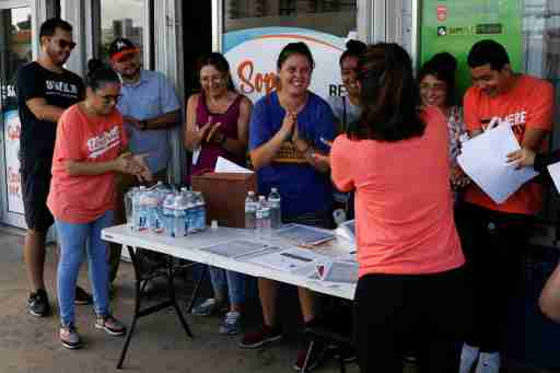 Immigration rights activists meet during a event to hand out pamphlets as communities braced for a reported wave of deportation raids across the United States by Immigration and Customs Enforcement officers, in Miami, Florida, U.S. July 13, 2019.  REUTERS/Marco Bello - RC1E69650CB0