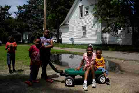 Kids play outside of their home in the West Washington neighborhood in South Bend, Indiana, U.S., June 26, 2019. Picture taken June 26, 2019. REUTERS/Joshua Lott - RC1BE196F320