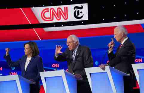 Democratic presidential candidate Senator Bernie Sanders speaks as Senator Kamala Harris and former Vice President Joe Biden listen during the fourth U.S. Democratic presidential candidates 2020 election debate in Westerville, Ohio, U.S., October 15, 2019. REUTERS/Shannon Stapleton - HP1EFAG05F29M