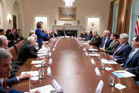 Speaker of the House Nancy Pelosi stands and speaks to U.S. President Donald Trump during an October 16 meeting about Syria between lawmakers, the president and members of the Trump administration in the White House cabinet room in an official White House handout photo released by the White House in Washington, U.S. October 17, 2019. Picture taken October 16, 2019.  Shealah Craighead/The White House/Handout via REUTERS   THIS IMAGE HAS BEEN SUPPLIED BY A THIRD PARTY. - RC175A7B6990