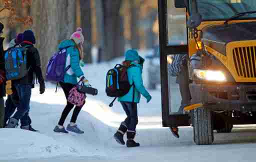 "Students board their school bus in a sub-zero temperature in Minneapolis, January 8, 2014. A deadly blast of arctic air shattered decades-old temperature records as it enveloped the eastern United States on Tuesday, snarling air, road and rail travel, driving energy prices higher and overwhelming shelters for homeless people. According to AccuWeather.com, the extreme cold won't last much longer. The frigid air and ""polar vortex"" that affected about 240 million people in the United States and southern Canada will depart during the second half of this week, and a far-reaching January thaw will begin, according to AccuWeather.com.  REUTERS/Eric Miller (UNITED STATES - Tags: ENVIRONMENT EDUCATION) - GM1EA190G4I01"