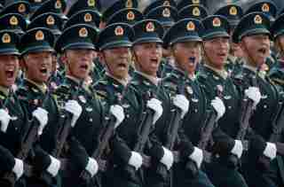 Soldiers of People's Liberation Army (PLA) march in formation past Tiananmen Square during the military parade marking the 70th founding anniversary of People's Republic of China, on its National Day in Beijing, China October 1, 2019. REUTERS/Jason Lee - SP1EFA10HSD12