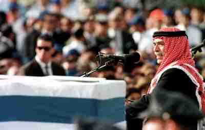 King Hussein of Jordan eulogizes Prime Minister Yitzhak Rabin over the coffin of the slain Israeli leader during the funeral service November 6 - PBEAHUNEPDF