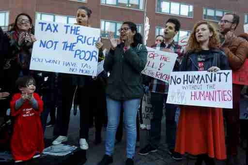Graduate students and others rally against the proposed GOP tax reform bill at Union Square in the Manhattan borough of New York City, New York, U.S., November 29, 2017. REUTERS/Shannon Stapleton - RC1BAA1EABA0