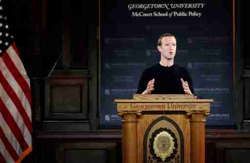 """Facebook Chairman and CEO Mark Zuckerberg addresses the audience on """"the challenges of protecting free speech while combating hate speech online, fighting misinformation, and political data privacy and security,"""" at a forum hosted by Georgetown University's Institute of Politics and Public Service (GU Politics) and the McCourt School of Public Policy in Washington, U.S., October 17, 2019. REUTERS/Carlos Jasso - RC1CB9578F30"""