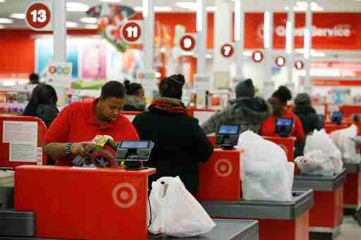 Cashiers check out for Thanksgiving Day shoppers at a Target store in Chicago, November 27, 2014. REUTERS/Andrew Nelles (UNITED STATES - Tags: BUSINESS SOCIETY) - GM1EABS0QE601