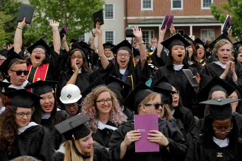 Graduating seniors react during Commencement ceremonies at Smith College in Northampton, Massachusetts, U.S., May 21, 2017.   REUTERS/Brian Snyder - RC1F1F41DBB0