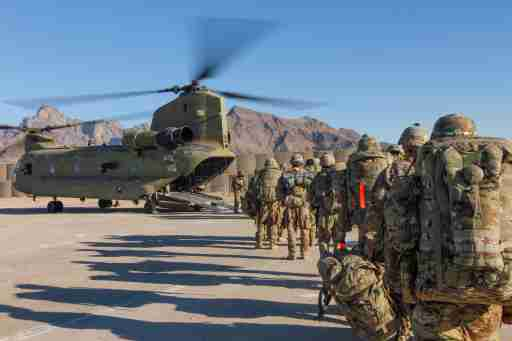 Soldiers attached to the 101st Resolute Support Sustainment Brigade, Iowa National Guard and 10th Mountain, 2-14 Infantry Battalion, load onto a Chinook helicopter to head out on a mission in Afghanistan, January 15, 2019.     1st Lt. Verniccia Ford/U.S. Army/Handout via REUTERS   ATTENTION EDITORS - THIS IMAGE WAS PROVIDED BY A THIRD PARTY. - RC110D3B25B0