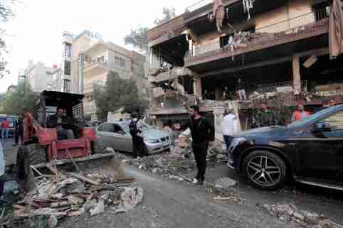 A tractor cleans debris outside a damaged building in Mezzah, Damascus, Syria November 12, 2019. REUTERS/Omar Sanadiki - RC2J9D9H43XW