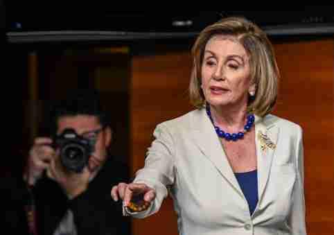 House Speaker Nancy Pelosi (D-Calif.) returns to the stage to address Sinclair reporter James Rosen on Capitol Hill on Thursday. (Erin Scott/Reuters)