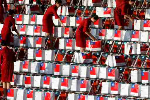 Staff members place boxes in chairs before the National Day celebrations in front of the Presidential Palace in Taipei, Taiwan, October 10, 2019. REUTERS/Eason Lam - RC1A7C3144B0