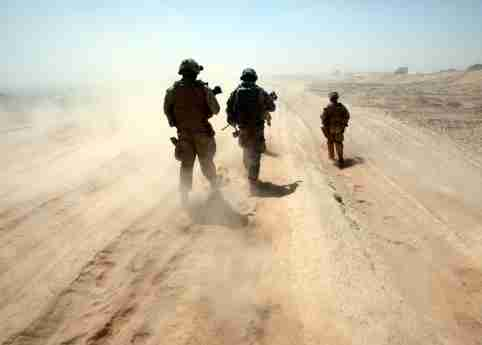 U.S. Marines walk around a base in Helmand province, southern Afghanistan, September 3, 2009.REUTERS/Goran Tomasevic (AFGHANISTAN CONFLICT POLITICS IMAGES OF THE DAY) - GM1E593173U01
