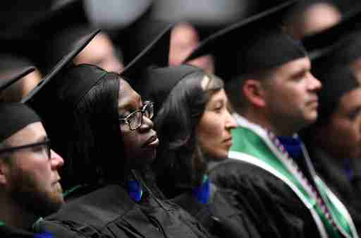 Students listen to the student speaker during the graduation ceremony for the College of Business in Moby Arena at Colorado State University in Fort Collins, Colo. on Friday, Dec. 20, 2019.122019 Csu Cobgraduation 08 Bb