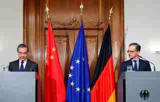 German Foreign Minister Heiko Maas and Chinese Foreign Minister Wang Yi hold a joint news conference in Berlin, Germany, February 13, 2020. REUTERS/Hannibal Hanschke
