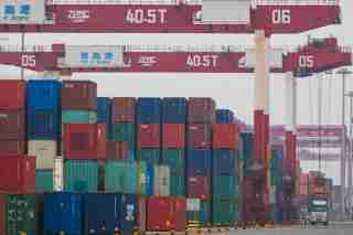 Containers are seen at a port in Qingdao, Shandong province, China July 11, 2019. Picture taken July 11, 2019. REUTERS/Stringer ATTENTION EDITORS - THIS IMAGE WAS PROVIDED BY A THIRD PARTY. CHINA OUT.