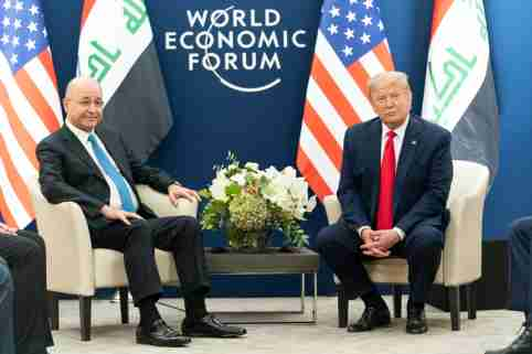 US President Donald Trump (R) and Iraqi President Barham Salih attend a bilateral meeting on the sidelines of the 50th World Economic Forum.