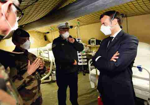French President Emmanuel Macron wearing face masks during the visit of the military field hospital outside the Emile Muller Hospital in Mulhouse, eastern France, on March 25, 2020, on the tenth day of a strict lockdown in France to stop the spread of COVID-19. Photo by Mathieu Cugnot/Pool/ABACAPRESS.COM