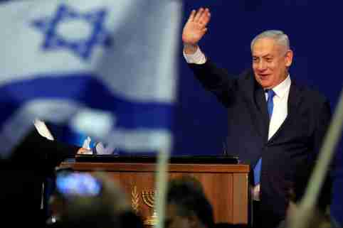 Israeli Prime Minister Benjamin Netanyahu waves to supporters following the announcement of exit polls in Israel's election at his Likud party headquarters in Tel Aviv, Israel March 3, 2020. REUTERS/Amir Cohen