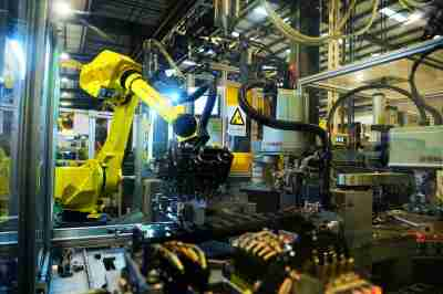 Staff work to produce auto parts with machines, which can help to save 2 minute and reduce production time to 30 seconds, at a factory in Suzhou city, east China's Jiangsu province, 25 November 2019.China has set up a $21 billion (£16.25 billion) national investment fund to promote the transformation and upgrading of the country's manufacturing industry, the official Shanghai Securities News reported on Wednesday. The fund will invest in both growth-stage and mature companies in areas such as new materials, next-generation information technology (IT) and power equipment, the newspaper said. The new fund will invest throughout the entire manufacturing industry value chain. fachaoshiNo Use China. No Use France.