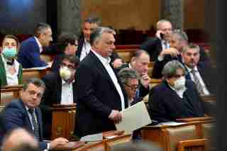 FILE PHOTO: Hungarian Prime Minister Viktor Orban arrives to attend the plenary session of the Parliament ahead of a vote to grant the government special powers to combat the coronavirus disease (COVID-19) crisis in Budapest, Hungary, March 30, 2020. MTI Zoltan Mathe/Pool via REUTERS/File Photo