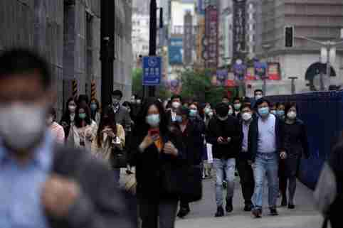 People wearing face masks walk at a main shopping area, following an outbreak of the novel coronavirus disease (COVID-19), in Shanghai, China May 6, 2020. REUTERS/Aly Song